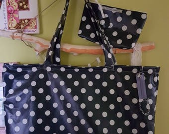 Blue and white polka dot oilcloth bag with zipper and matching clutch bag