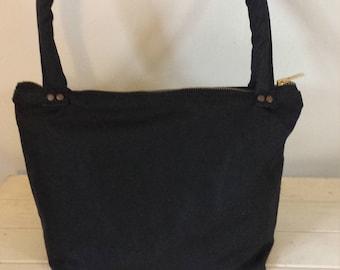 Black waxed canvas handbag
