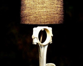 The ultimate bedside piston lamp