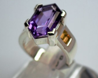 Silver ring set with amethyst and citrine