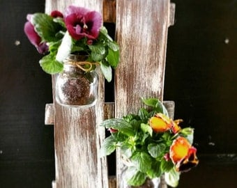 Vintage wood wall decoration with flower pots