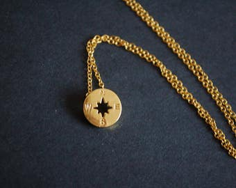Gold tone compass necklace