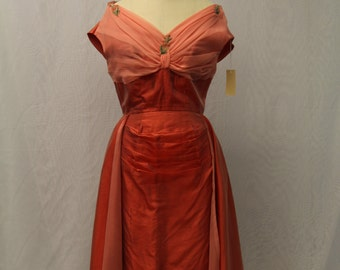 1950's Coral taffetta tea length dress with organza bodice overlay with beaded features and pleats