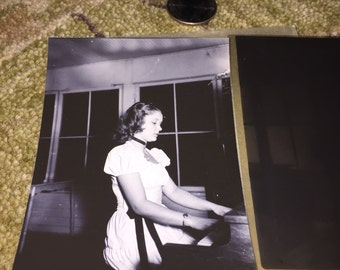 Black and white photo of woman playing piano