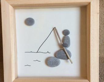 Pebble art - fisherman