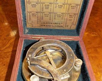 boxed brass compass marked J H Steward