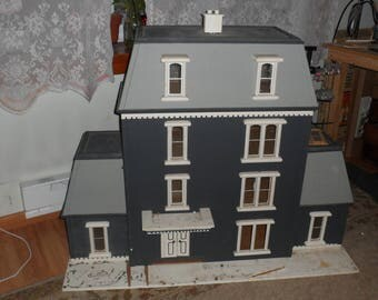 dollhouse measures 39 inches high by 4 feet long by 19 inches wide