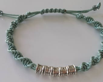Teal spiral macrame bracelet with silver plated metal beads