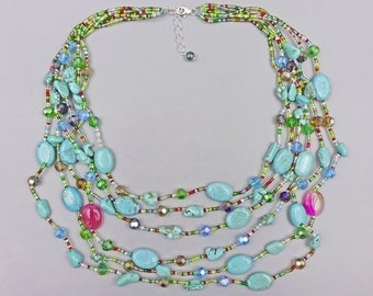 "24"" six stranded necklace. Made of Magnesite beads and crystals."