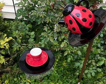 lady bug tea pot bird feeder