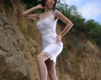 Short white embroidered lace dress ideal for weddings or special occasions