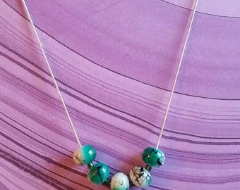 Green and white acrylic bead necklace