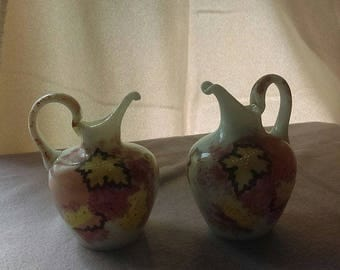 A pair of ceramic vases with Autumn leaves