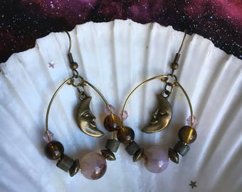Dangle hoop earrings with moon charm.