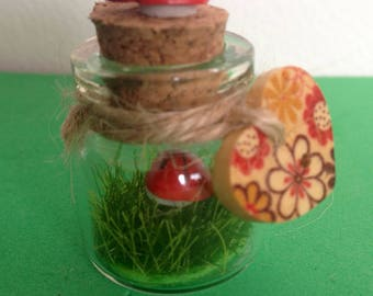 Mini bottle garden pets fun collectible. Faux grass. Height 1 inch.