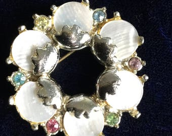 Vintage Hollywood mother of pearl brooch with paste stones