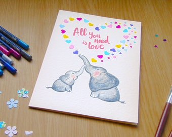 """Drawn elephants sing """"All you need is love """""""