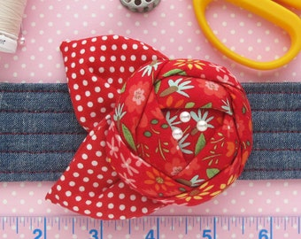Flower Wrist Pin Cushion Cuff | Wrist pincushion sewing accessory made from chambray and a red floral quilting cotton. Great sewing gift!