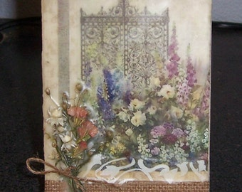 Dried flower and encaustic wax collage on canvas