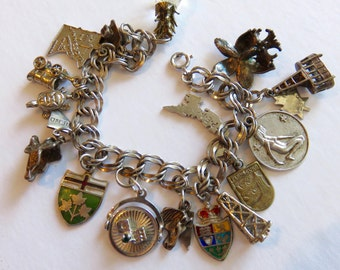 SJK Vintage -- Sterling Silver Double Link Charm Bracelet with Sixteen Sterling Charms (1960's-70's)