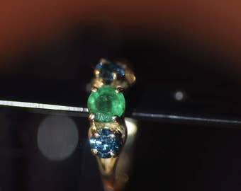 14K Gold Ring with a Center Round  Emerald and Blue Diamond Accents