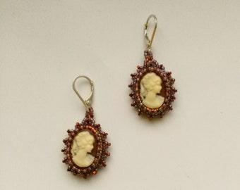 Beadwoven Cameo Earrings . Beaded Earrings . Golden Copper Earrings . Sterling Silver Leverback Earrings . Dangle Pierced . White Carving