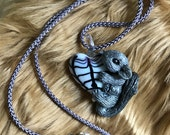 Silver Sugar Glider Pendant - Silver Coated Glider on a Black and White Glass Heart