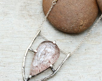 Melody stone pendant necklace in silver prongs and bezel setting with aquamarine on the side on sterling silver chain/TP