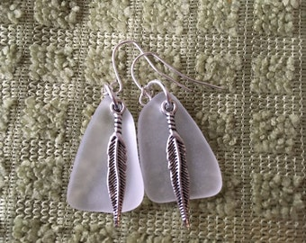 Lovely white sea glass dangle earrings embellished with feathers beach glass inspired jewelry