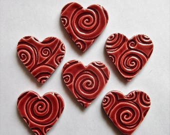 6 cherry red hearts with embossed swirlie designs