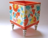 ceramic Planter with whimsical striped beetlejuice legs, polka-dots floral pattern w/ turquoise, yellow, & bright orange