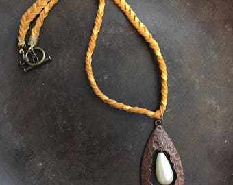 Yellow braided leather cord with textured patina colored pendant with pearl dangle choker necklace