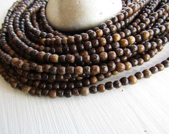 Small Robles round wood beads , brown tone, Natural exotic supplies , Philippines  , 4mm to 5mm  ( full strand ) 6PH17