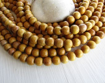 Nangka round wood beads  , yellow wood, natural exotic supplies  from Philippines  8 mm to 9 mm  (50 beads ) 6ph15