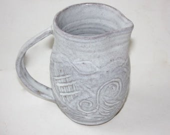 Stoney White Pitcher Abstract Carved Decoration Holds Three Cups Plus Mat White Glaze over Brown Stoneware Clay Body