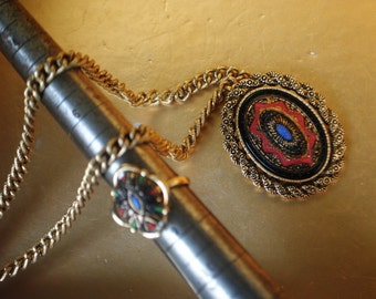 Boho vintage 70s gold tone metal necklace with a pendant-brooch and matching adjustable ring. Made by Sarah Coventry.