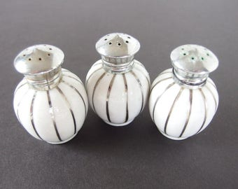 3 Vintage Salt and Pepper Shakers,  White with Silver from An Irice