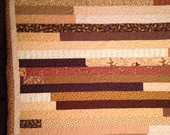 "Twin Size Quilt, strip quilt, scrappy strips, 64""x86"". machine quilted, jelly role quilt, brown prints"