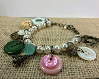 """Vintage pearl and button """"Paris"""" charm bracelet"""