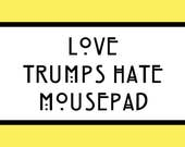 Mousepad LOVE TRUMPS HATE for purchase by Scalenda7