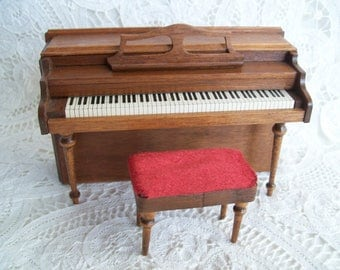 Miniature, one inch scale, Hand Crafted Piano and Bench by Robert Ikier in 1977