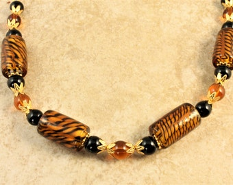 SPRING SALE Tiger Striped Black and Amber Glass Beaded Necklace with Gold Plated Chain