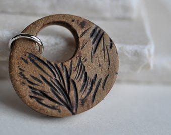 Evergreen Ceramic Pendant in natural brown clay, impressed with a real Wisconsin pine branch