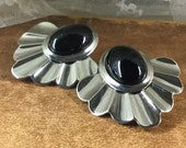 Bold Black Lucite Cabochon and Silver Tone Metal Fan Shaped Earrings Pierced Unsigned Pleated Metal Oval Cabochon 1980's