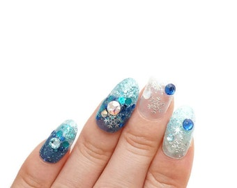 Nails, winter nails, snowflakes, frozen nail art, princess nails, ice queen, Japanese nails, blue nail, white nail, snow nail, glittery nail