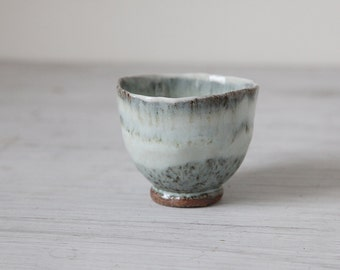 1 Hand built stoneware and Porcelain 4 oz cup with pretty blue glaze
