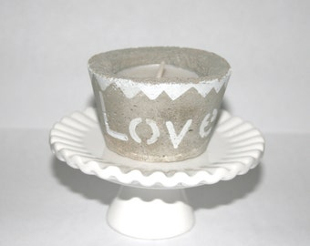 Tea lite candle holder painted with the word LOVE and distressed