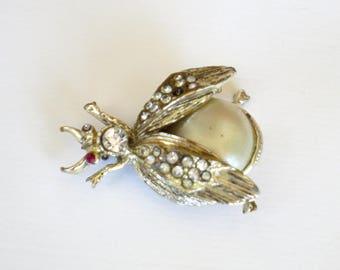 silvertone and pearl bug brooch