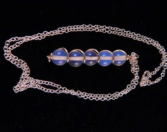 Moonstone Pendant set in Sterling Silver Wire on a Sterling Silver Chain, PN1