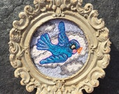 Bluebird tattoo flash inspired embroidery art in vintage style frame